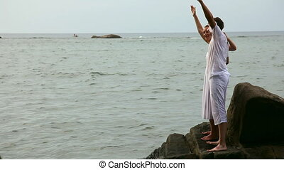 Couple. - Happy couple on a rock in a ocean.