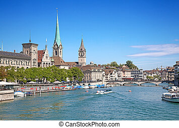 Zurich in summer - Limmat river and famous Zurich churches