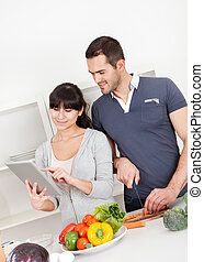 Young couple cooking at home