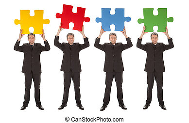 Group of business people holding jigsaw puzzle Isolated on...