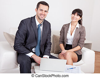Two business people at the meeting - Two business people...