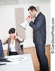 Angry boss screaming at employee