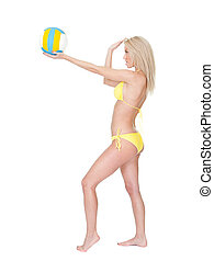 Beautiful young woman in bikini playing volleyball. Isolated...