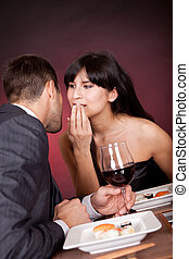 Young couple having romantic conversation at restaurant