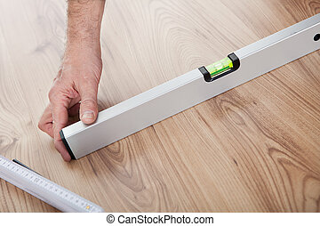 Worker working on laminate floor