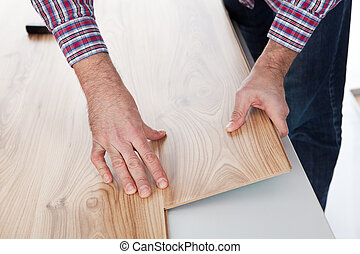 Worker assembling laminate floor