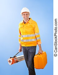 Senior land surveyor with theodolite equipment
