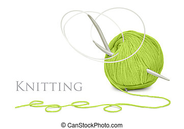 green wool and knitting needles - ball of green wool and...