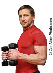 man with a dumbells - Athletic man with a dumbells over...
