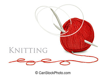 red wool and knitting needles - ball of red wool and...