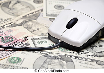 E-commerce concept image. - computer mouse on dollars...