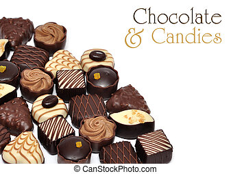 chocolate candies - hand made chocolate candies over white...