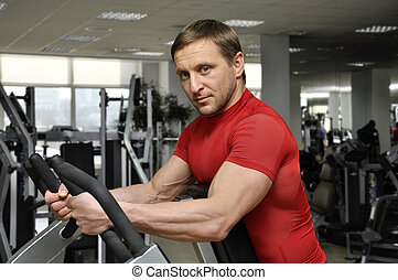 men exercising - handsome men exercising in the gym