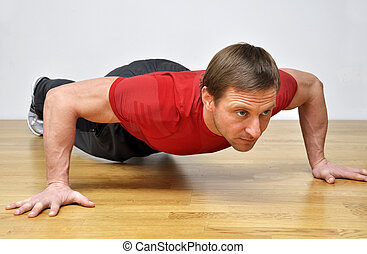 man doing pushup fitness exercise - Handsome fit man...