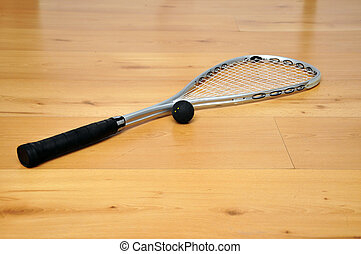 squash racket and ball - a squash racket and ball on the...