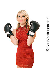 Charming blond girl in boxing gloves