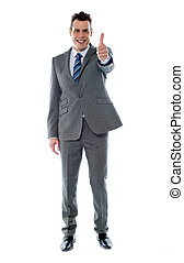 Confident businessman gesturing thumbs up
