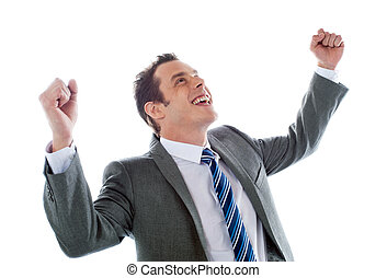 Businessman celebrating success with arms up isolated over a...