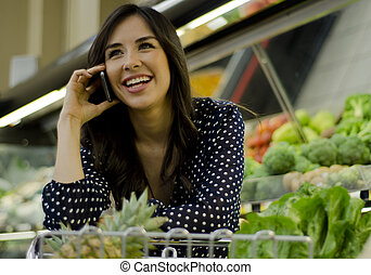 Woman talking on the phone - Young beautiful woman with a...