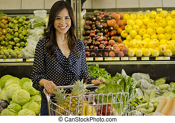 Cute woman at the grocery store - Young beautiful woman with...