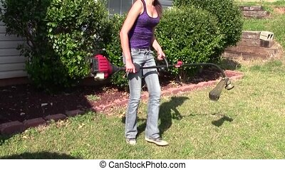 Yard Work - Teen girl starting and using string trimmer
