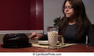 Snack Time - Teen having cake and milk