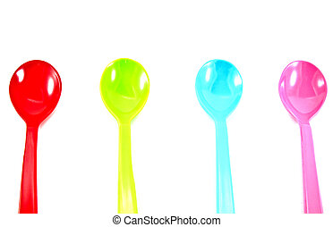 Colorful plastic spoons on white background