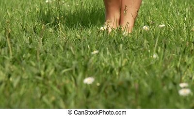 Woman Walking in Grass