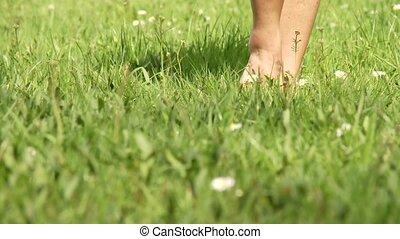 Woman Walking in Grass