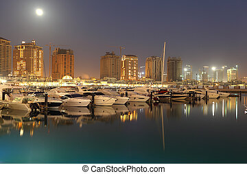 Porto Arabia at dusk. The Pearl in Doha, Qatar