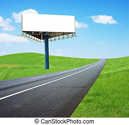 Highway billboards - blank white billboard on the edge of...