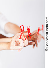 multiracial group of people with aids ribbon supporting hiv...