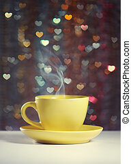 A cup of tea - Yellow cup of tea in the background bokeh in...