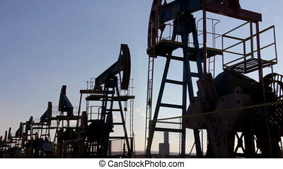 many working oil pumps silhouette