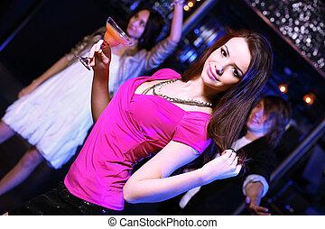 Young woman having fun at nightclub disco