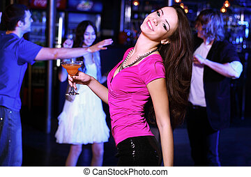 Young woman having fun at nightclub disco - Young woman...