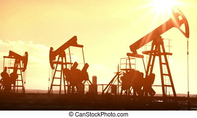 working oil pumps silhouette - old movie styled
