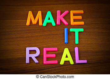 Make it real in colorful toy letters on wood background