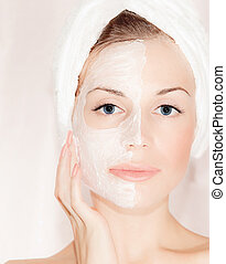 Facial mask on beautiful face, closeup portrait on female...