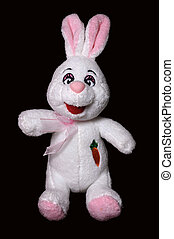 Soft toy. Hare isolated on black background