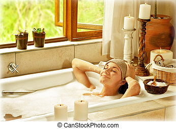 Woman taking bath, happy female relaxing at spa resort,...