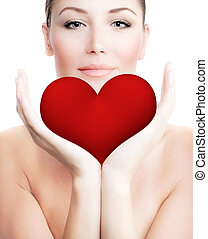 Beautiful woman holding big red heart in hands, sensual...