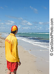 life saver - young man life saver watching the situation on...