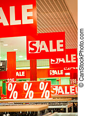 Lots of sale signs in clothing store