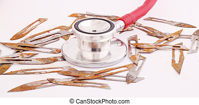 scalpels - Rusty scalpels with a red stethoscope