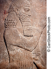 Ancient relief of Sumer king - Ancient clay relief of an...