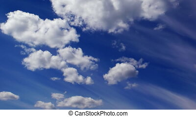 evaporating clouds in summer sky