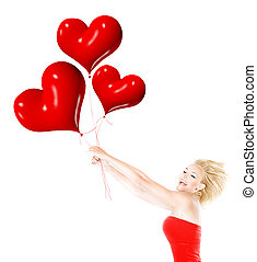 Happy girl flying, holding red heart balloons - Happy girl...