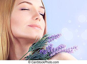 Lavender spa aromatherapy - Young woman enjoying lavender...