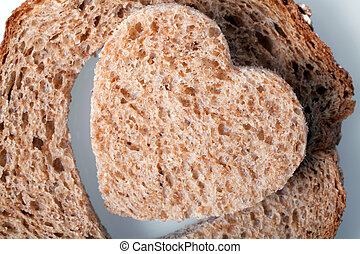 Heart shaped hole in a slice of bread